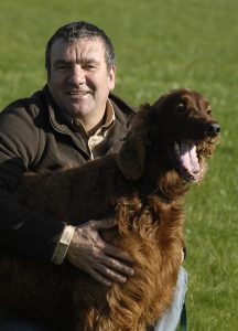 dog fence installer with red setter after training